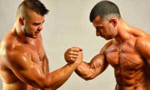 Strong bodybuilders testing their biceps in a skandemberg contest