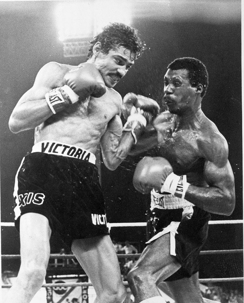 FILE - In this Jan. 28, 1978 file photo, Nicaragua's junior lightweight fighter Alexis Arguello, left, cuts into Puerto Ricos' Alfredo Escalera with a strong left in the ninth round of their World Boxing Council title fight near San Juan. Arguello, three-time world boxing champion, who once fought against the Sandinistas in the 1980s, but joined the party to win election as mayor of Managua in 2008, was found dead Wednesday, presidential spokeswoman Rosario Murillo said. (AP Photo, File)