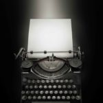 Vintage typewriter against black background