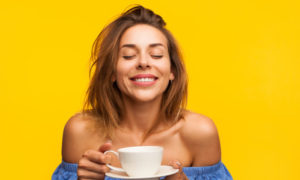 Smiling woman enjoying coffee