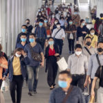 crowds of Asian people wearing face protection from infection of Corona virus or Covid -19 outbreak, pandemic,and epidemic while going to their workplace