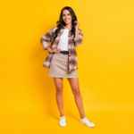 Photo of charming elegant lady toothy white smile wear plaid shirt short skirt footwear isolated yellow color background